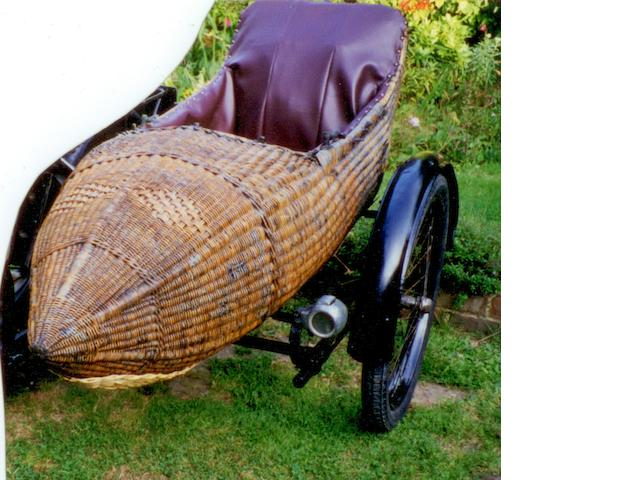 A circa 1913 wicker motorcycle sidecar,