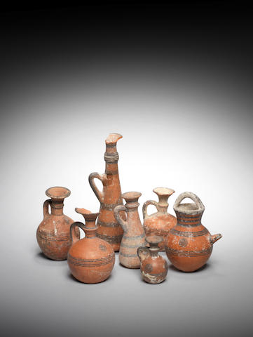 Seven small Cypriot black on red ware pottery vessels 7