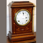 An American walnut and inlaid mantel clock