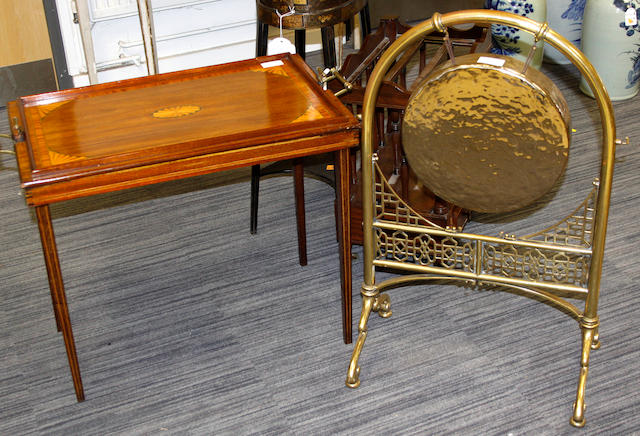 An Edwardian mahogany tray/table, a late Victorian/Edwardian brass dinner gong; and a Victorian copper helmet shaped coal scuttle