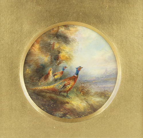 A Royal Worcester circular plaque with pheasants by James Stinton