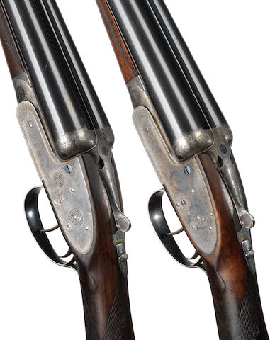 A fine pair of 12-bore self-opening sidelock ejector guns by J. Purdey & Sons, no. 21923/4 In their brass-mounted oak and leather case