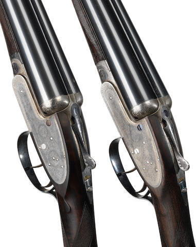 A pair of 12-bore self-opening sidelock ejector guns by J. Purdey & Sons, no. 20131/2 In a later James Purdey & Sons leather motor-case