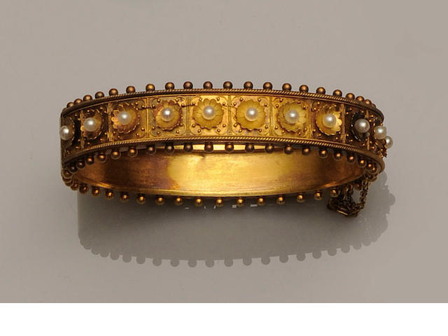 A Victorian gold pearl flowerhead hinged bangle