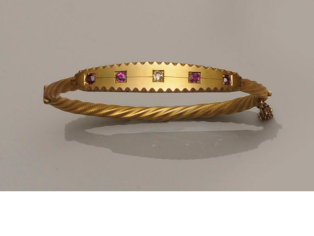 A Victorian diamond and ruby set hinged bangle