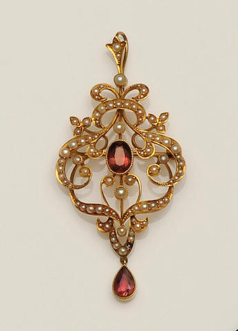 A late 19th century gold mounted tourmaline and seed pearl cartouche brooch/pendant