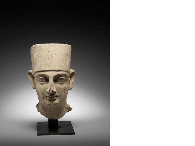 A Palmyran stucco head of a priest