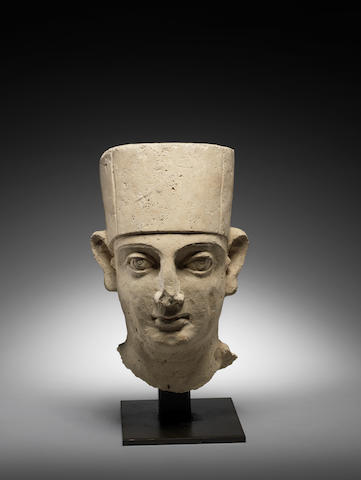 A Palmyran stucco head of a priest