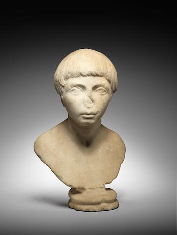A Roman marble bust of a young man