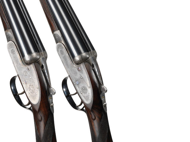 A pair of 12-bore self-opening sidelock ejector guns by J. Purdey & Sons, no. 23451/24060 In their canvas motor case