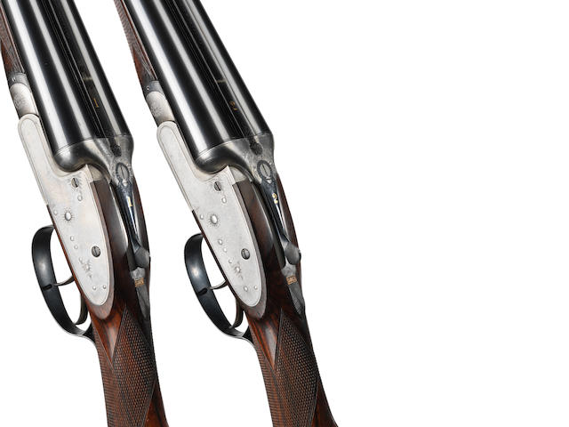 A pair of 12-bore 'W&R Plain Hammerless Ejector' sidelock ejector guns by Charles Lancaster, no. 8530/1 In their leather case