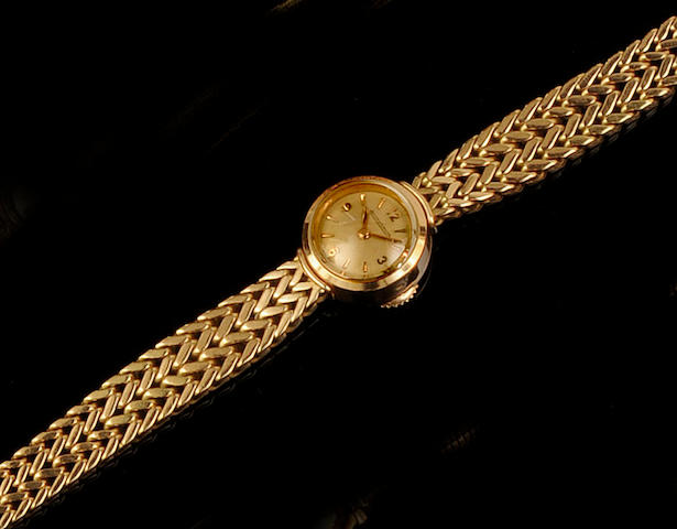Jaeger Le Coultre: A lady's 18ct gold bracelet watchCase No. A651376, circa 1950
