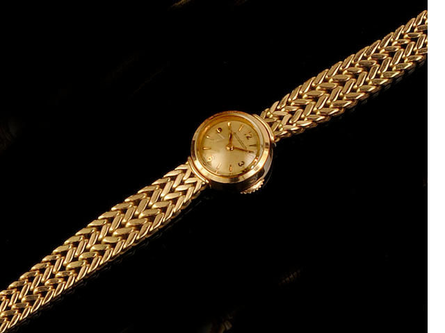 Jaeger Le Coultre: A lady's 18ct gold bracelet watch Case No. A651376, circa 1950
