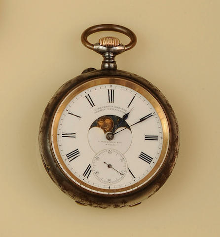 An open face pocket watch with moonphase and calendar