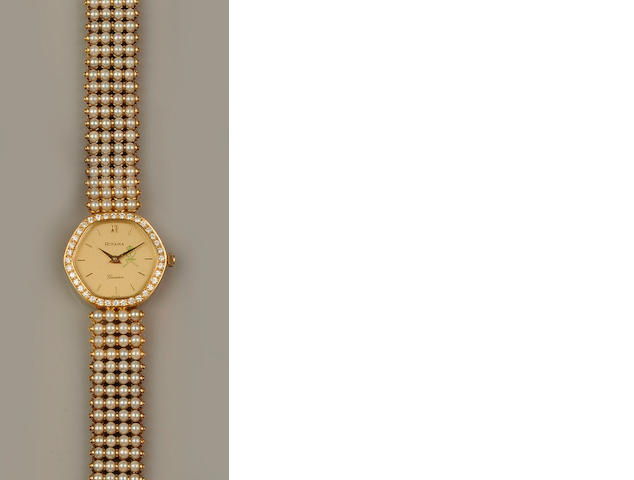 Royama: A lady's diamond and pearl set wristwatch