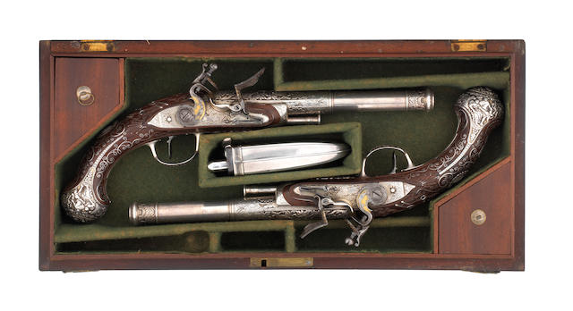 An Exceptional Cased Pair Of Indian 28-Bore Silver-Mounted Flintlock Pistols With Silver Barrels And Lock-Plates