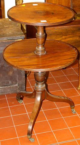 A George III mahogany two tier circular dumb waiter,