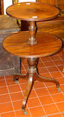 A George III mahogany two tier circular dumb waiter,