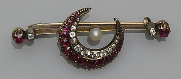 A diamond, ruby and pearl crescent bar brooch