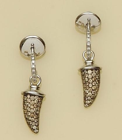 A pair of diamond and horn-shaped earpendants, by Theo Fennell