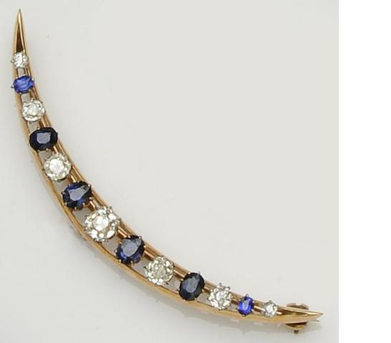 A diamond and sapphire crescent brooch