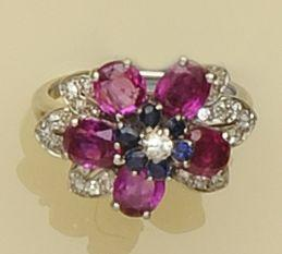 A ruby, sapphire and diamond cluster ring