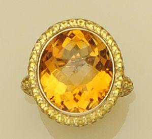 A citrine dress ring, by Theo Fennell