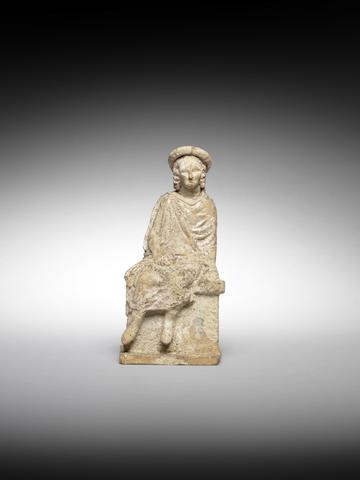 A tanagra terracotta seated figure