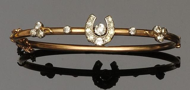 A diamond horseshoe set hinged bangle