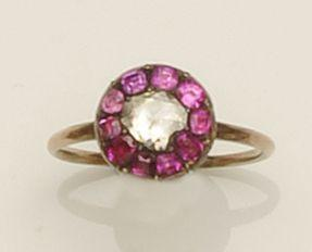 A ruby and rose diamond cluster ring