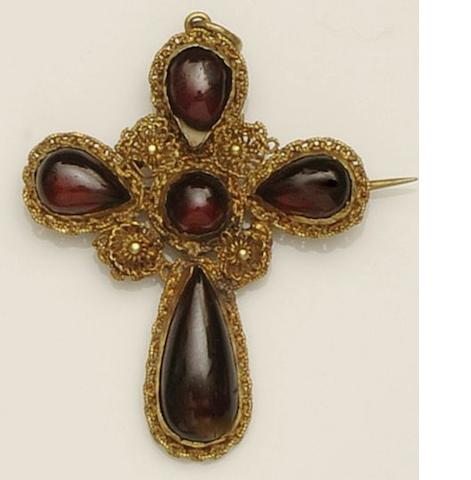 A Victorian garnet set cross pendant and a horseshoe pendant (2)