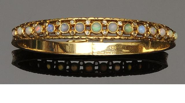 An opal and diamond bangle