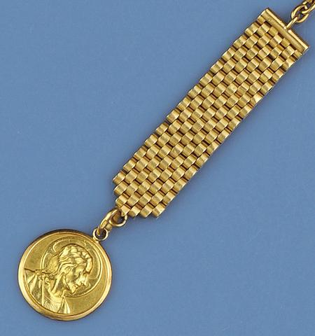 A yellow precious metal keychain