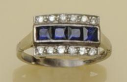 A diamond and sapphire triple row ring