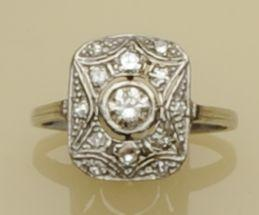 A diamond set panel ring