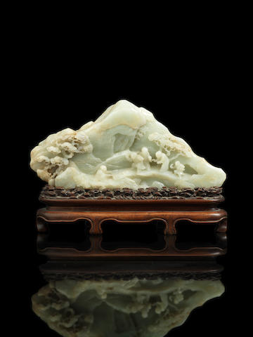 A magnificent and important pale green jade mountain, 18th century, Dedicated by Li Hong Zhang to Prince Gong; wood stand