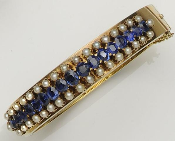 A sapphire and half pearl bangle