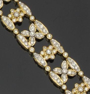 An 18ct gold diamond set bracelet
