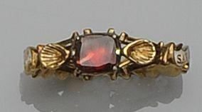 A mid-18th century enamel and garnet memorial ring