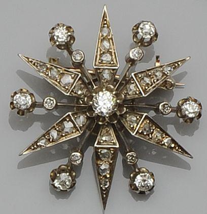 A diamond star brooch