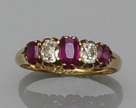 A ruby and diamond five stone ring