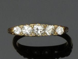 A five stone diamond boat-shaped ring
