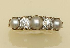 A diamond and half pearl five stone ring