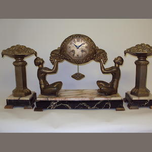 A marble and gilt-spelter clock garniture