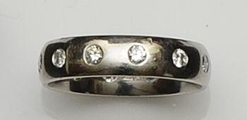 A platinum and diamond set band ring