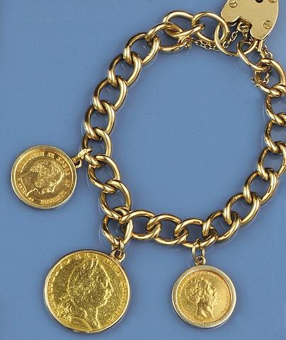 A gold curb-link bracelet suspending coin fobs (7)