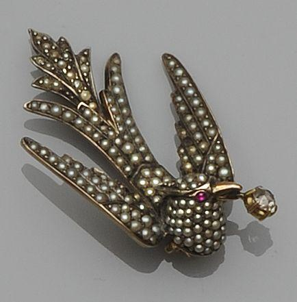 A late Victorian gem set bird brooch