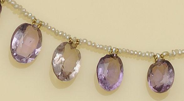 An Edwardian amethyst and seed pearl necklace and a Victorian amethyst cross brooch (2)
