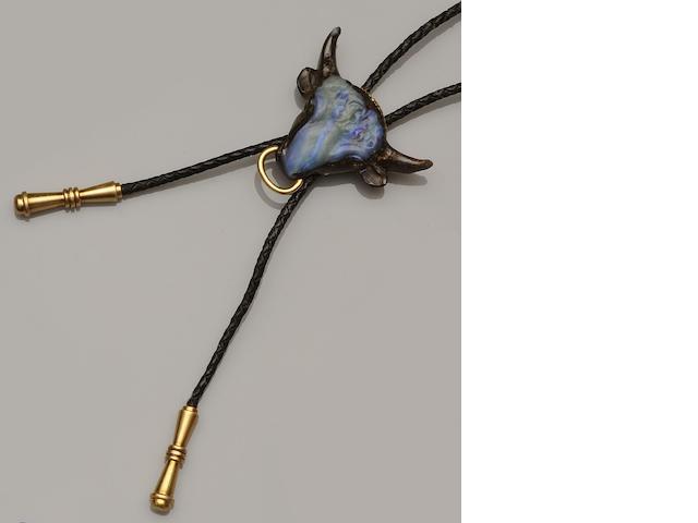 A carved opal matrix bull's head bolo tie