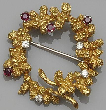 An 18ct gold ruby and diamond wreath brooch, circa 1970s